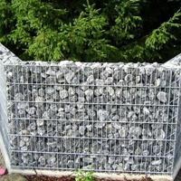 Забор из дикого камня в металлической сетке